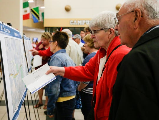 Mary Ann and Vern Wagner of Plymouth look over proposed