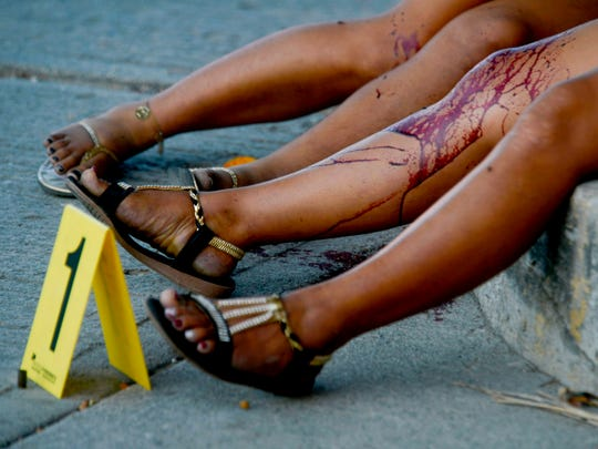 The bodies of women lie on the sidewalk in the Rufo