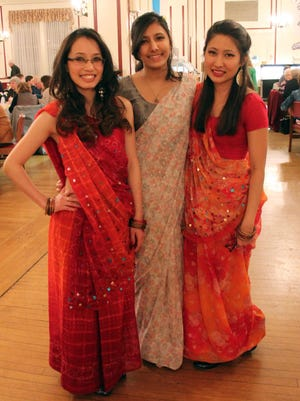 In this 2013 file photo, Neena Gurung, Amrisha Vaidya and Kisha Pradhan pose in their native dress from Nepal during the annual Muhibbah dinner at Wilson.