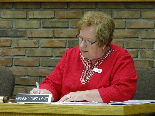 Love takes notes during City Council meeting