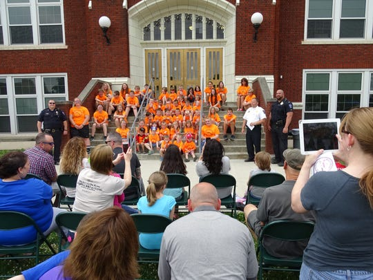 Many proud parents took photos as their children graduated from Safety Town on Friday at the Bucyrus Elementary School.