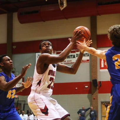 Ouachita forward Williw Lapoole jumps as he attempts