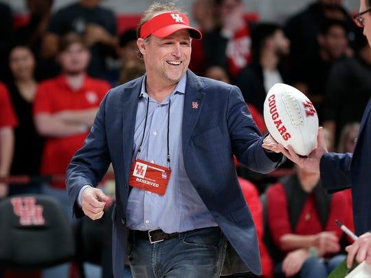 Dana Holgorsen gets autographed footballs to toss to