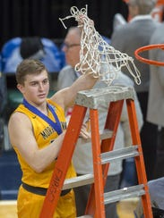 Hayden Langkabel (25) thrusts the game net into the air after Morristown won the IHSAA Boys' Basketball Class A State Finals game at Bankers Life Fieldhouse, Saturday.