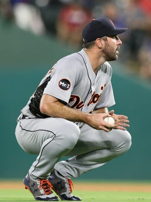 Tigers pitcher Justin Verlander reacts after giving up a home run against Rangers first baseman Mike Napoli in the fourth inning on Tuesday, Aug. 15, 2017, in Arlington, Texas.