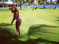 Beyonce enjoys a round of golf in a bright, striped bikini.