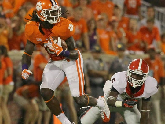 Clemson's Sammy Watkins bounces off of Georgia's Damian Swann en route to a 77-yard touchdown during the first quarter of their game on August 31, 2013.