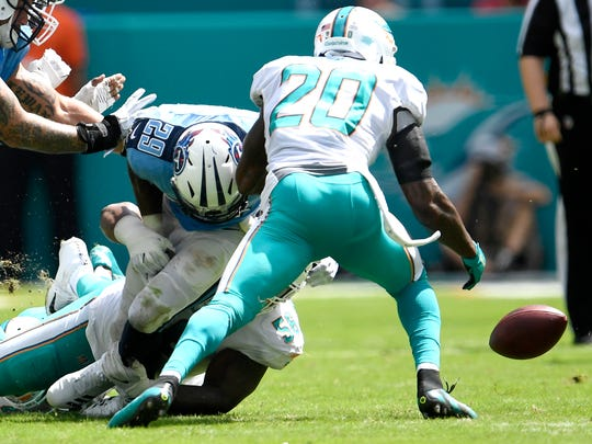 Titans running back DeMarco Murray (29) fumbles in