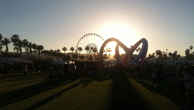 The sun sets over the Coachella Valley Music and Arts Festival at the Empire polo Club in Indio on Friday.