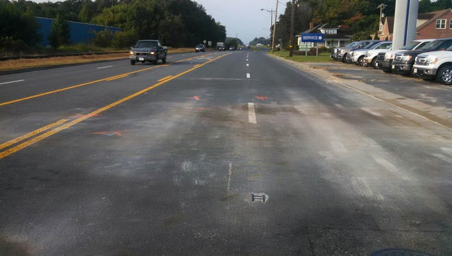 There is no divided median on Route 13 where a van crossed the road Saturday night and struck a car, killing three, in Accomack County