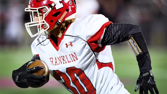 Franklin's Robert McAllister carries the ball in the