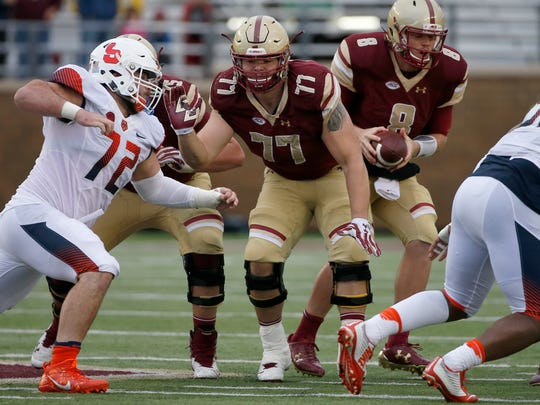 Boston College offensive lineman Jon Baker (77) blocks for quarterback Patrick Towles during the second half of an NCAA college football game against Syracuse, Saturday, Oct. 22, 2016, in Boston. (AP Photo/Mary Schwalm)