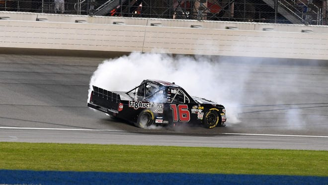 NASCAR Camping World Truck Series driver Brett Moffitt (16) does a burnout after winning the Overtons 225 at Chicagoland Speedway.