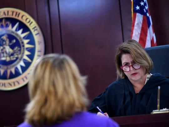 Judge Melissa Blackburn listens to Marjorie Jeter during