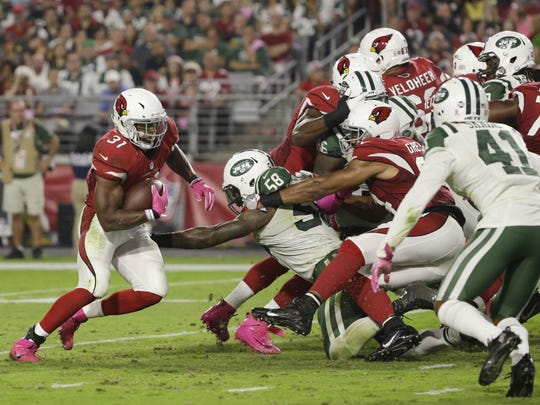 Cardinals David Johnson runs for his third touchdown against the Jets in the second half on Oct. 17, 2016 in Glendale, AZ.