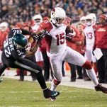 Arizona Cardinals wide receiver Michael Floyd (15) makes a reception past Philadelphia Eagles cornerback Eric Rowe (32) during the first half at Lincoln Financial Field.