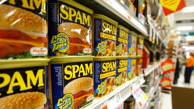 Cans of Spam line the shelves at a store in Berlin, Vt.