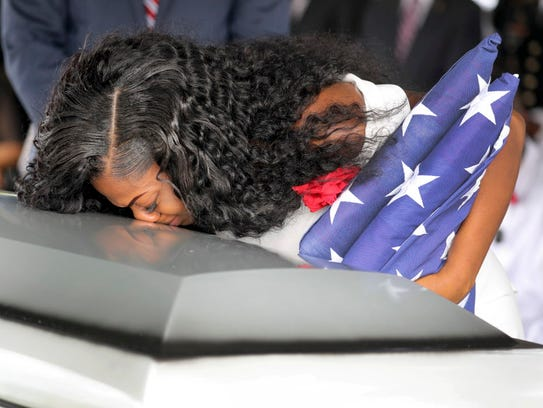 Myeshia Johnson, the widow of Army Sgt. La David Johnson, kisses her husband's casket during the funeral service at the Hollywood Memorial Gardens in Hollywood, Fla., on Oct. 21, 2017. Sgt. Johnson was killed with three other colleagues in an ambush by extremists in Niger on Oct. 4.