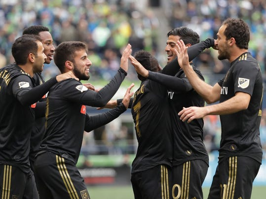 Los Angeles FC forward Diego Rossi, third from left, celebrates with teammates after he scored a goal against the Seattle Sounders during the first half of an MLS soccer match, Sunday, March 4, 2018, in Seattle. (AP Photo/Ted S. Warren)