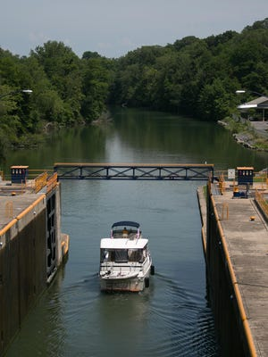A boat leaves lock 2 of the Cayuga-Seneca Canal in Seneca Falls on Wednesday, July 29, 2015. The lock is directly adjacent to lock 3, and they combine to lift and lower boats by 49 feet.