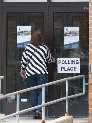 A voter enters Newark High School to vote on a school referendum.