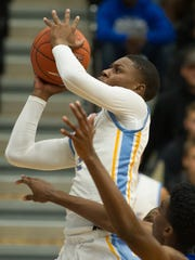 Cape Henlopen's Cory Barnes (2) goes up for a basket in their home game against Caesar Rodney.