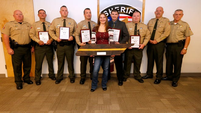 Major Steve Spence, Deputy Chief Egon Grissom, and Sheriff Mike Fitzhugh, honor employees who earned awards during a ceremony Tuesday, Sept. 12, 2017. From left are Steve Spence, School Resource Officer Jeff DeGennaro, and Patrol Deputy Joey Vann, who earned Life Saving Medals, Patrol Deputy George Barrett, who received a Medal of Valor, Communications Cpl. Bobbie Jackson, who received recognition for handling the radio when two suspected murderers from Georgia were apprehended, Deputy Mark Gregory and Deputy Chris Beach, who received Medals of Valor, Grissom and Fitzhugh.