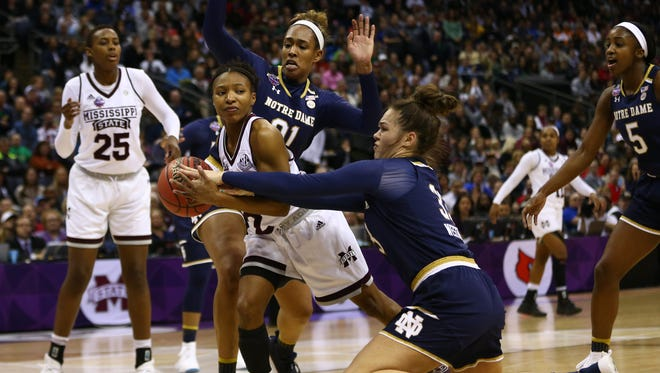 Mississippi State guard Morgan William tries to drive between Notre Dame defenders during the championship game of the 2018 NCAA tournament.
