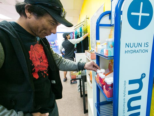 Rene Oinez, of Las Cruces, pics out a package of NUUN