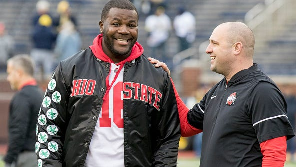 Former Ohio State Buckeyes quarterback Cardale Jones (left) and Ohio State Buckeyes assistant coach Zach Smith talk during warmups before the game between the Michigan Wolverines and the Ohio State Buckeyes at Michigan Stadium in Ann Arbor, Michigan, on November 25, 2017.