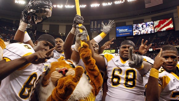 Grambling player celebrate after defeating Southern