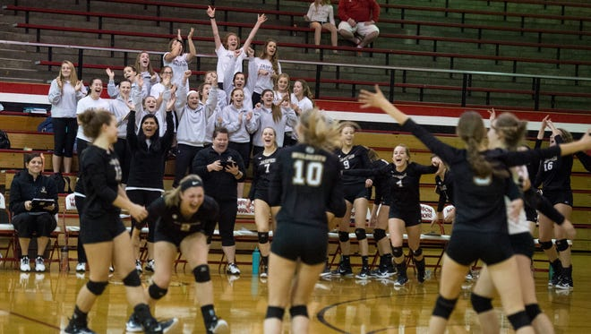 Jasper High School celebrates their win over Harrison High School in the second game of the 2017 IHSAA Volleyball Sectional tournament at Harrison High School in Evansville, Ind., on Friday, Oct. 13, 2017. Jasper won in three straight sets.
