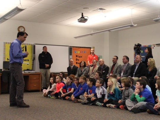 Gov. Scott Walker holds a conference with students and officials April 11 at Mountain Bay Elementary School in Weston.