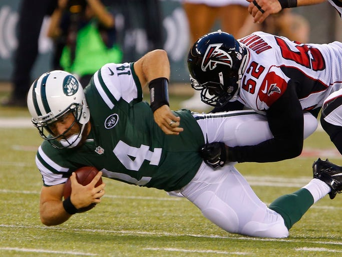 Falcons linebacker justin durant 52 brings down jets quarterback