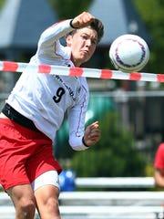 Austria's Thomas Reingruber spikes the ball vs. Brazil