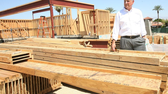 Windermere Southern California owner Bob Deville amid construction supplies on the site of the company's flagship office in Rancho Mirage. That building, completed in 2008, will remain headquarters for Bennion Deville Homes.