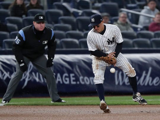 New York Yankees third baseman Ronald Torreyes can't contain a bad hop on a ball hit by Toronto Blue Jays' Yangervis Solarte during the fourth inning of Thursday's game.