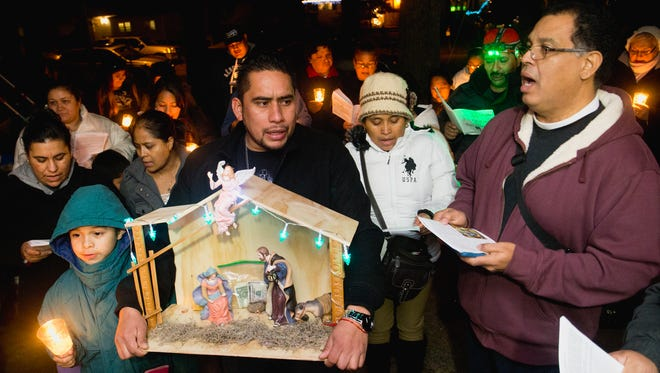 Parishioners of All Saints Episcopal Church observe the Hispanic Advent tradition of Las Posadas, Monday, December 21, 2015, in Lakewood.