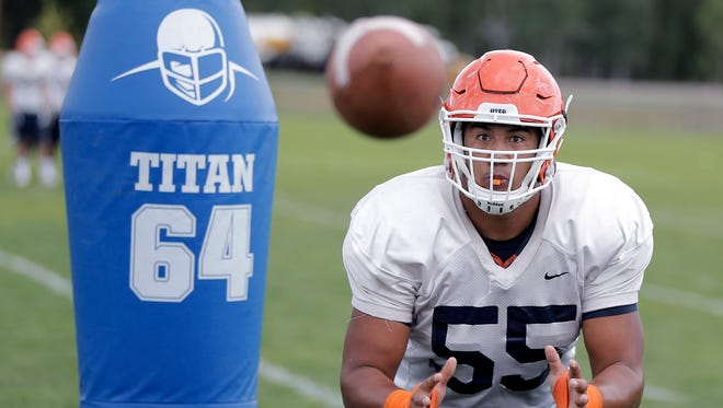 UTEP defensive lineman Mike Sota looks a pass into his hands during a drill Wednesday at Camp Ruidoso. The redshirt sophomore has impressed coaches and already has one interception at camp.