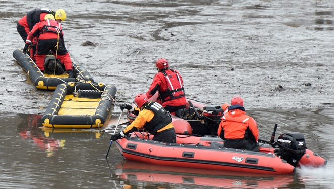First responders recover a body from the Hackensack River on Sunday afternoon. Emergency personnel from Hackensack, Bergenfield, Oradell and Teaneck responded to the scene behind the Shops at Riverside on Sunday, February 11, 2018.