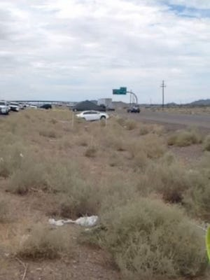 A DPS Trooper and a motorist were injured on I-10 near Casa Grande after police said the citizen tried to grab the Trooper's gun on July 29, 2015.
