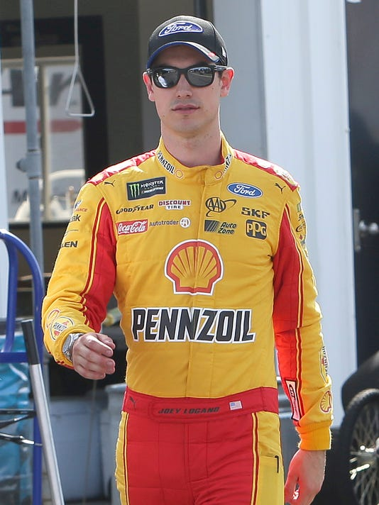 Joey Logano walks before qualifications for Sunday's NASCAR Cup Series auto race, Friday, Match 17, 2017, in Avondale, Ariz. (AP Photo/Rick Scuteri)