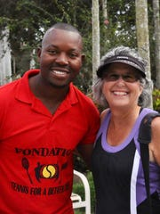 Palmira Director of Tennis Paul Segodo hosted a ProAm tournament to benefit his charitable foundation, Tennis for a Better Life, with help from Palmira members like Sherri Young, who organized food.