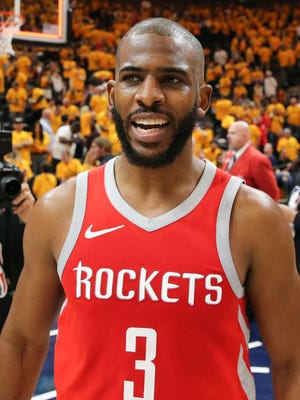 Houston Rockets guard Chris Paul reacts after defeating the Utah Jazz in Game 4 of the second round of the 2018 NBA playoffs.