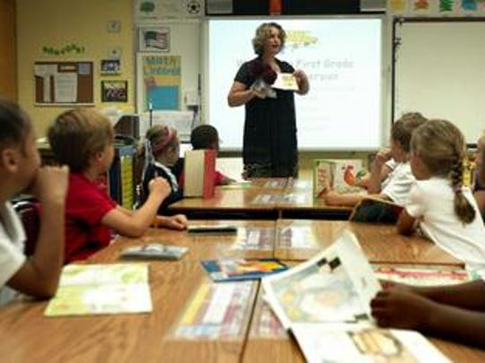 Karine Ruatta teaches students at Myrtle Place Elementary