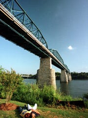 The Walnut Street Bridge has been restored as a pedestrian park that links Coolidge Park with downtown Chattanooga. The bridge is at the Tennessee River Park.