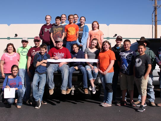 Luna County 4-H members hold a Peppers Supermarket