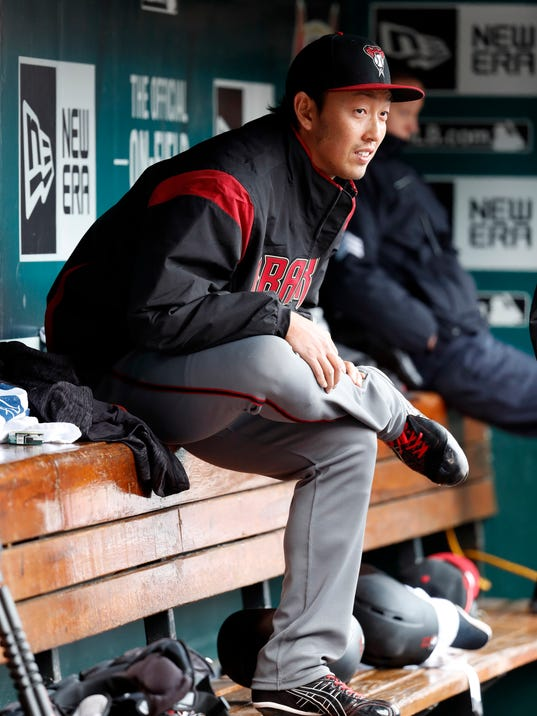 Arizona Diamondbacks relief pitcher Yoshihisa Hirano sits in the dugout during the eighth inning of a baseball game against the St. Louis Cardinals, Sunday, April 8, 2018, in St. Louis. (AP Photo/Jeff Roberson)