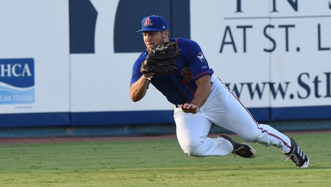 Tim Tebow attempts a catch during a St. Lucie Mets game against the Palm Beach Cardinals on Thursday, June 29, 2017 at First Data Field in Port St. Lucie.