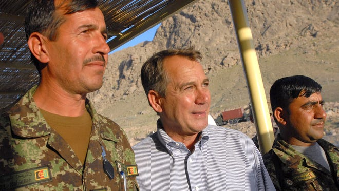 ORG XMIT: AFGH105 This handout photo provided by ISAF Regional Command (South) shows House Speaker John Boehner of Ohio posing for a photo with members of the Afghan military during a visit to the Arghandab Valley of Afghanistan, Wednesday, April 20, 2011. Boehner led a congressional delegation that met with members of the military, civilian agencies and Afghan officials to assess the ongoing military operations. (AP Photo/ U.S. Navy Ensign Haraz N. Ghanbari, ISAF Regional Command (South))